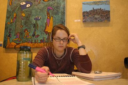 Northwestern University senior Nell Compernolle studies at the Unicorn Cafe, 1723 Sherman Ave.  Photo by MichaelJarecki.com