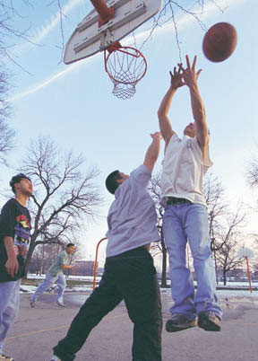 Playing basketball at McGuane Park
