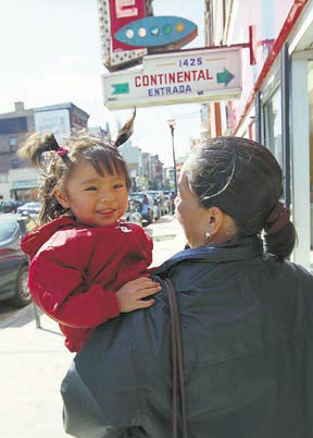 Mother and daughter walk down Milwaukee Ave.