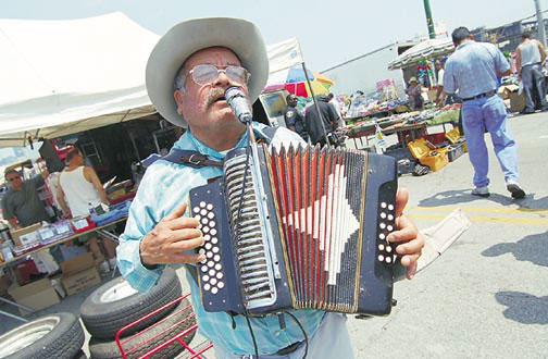 Playing the Mexican accordion at the Maxwell Street Market