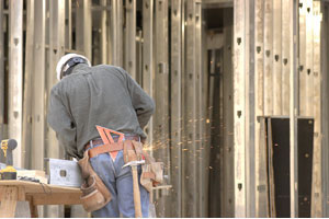 A construction worker laying the foundation for a highrise