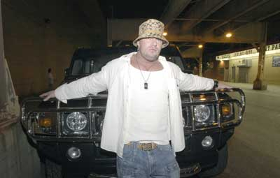 Tony Kotelman in front of his hummer